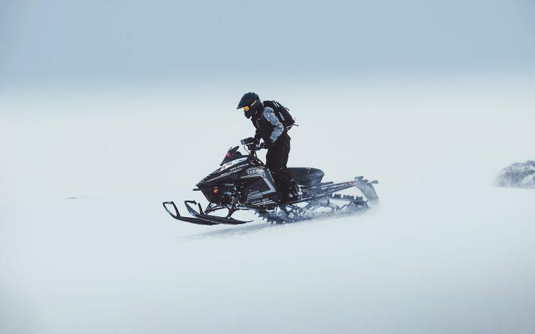 Fast paced snowmobile tour on Langjokull glacier