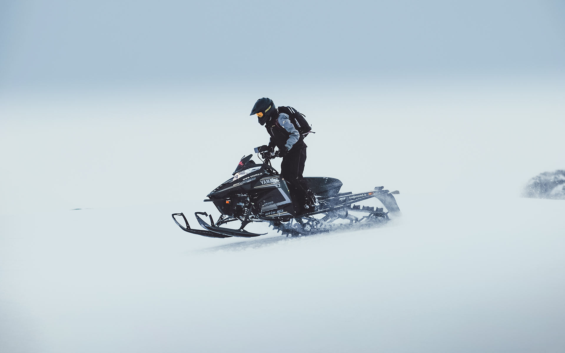 Fast paced snowmobile tour on Langjokull glacier